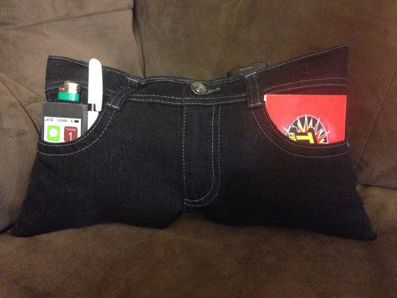 Upcycled recycled black denim jeans converted into tv remote control storage pockets pillow on Etsy, $10.00