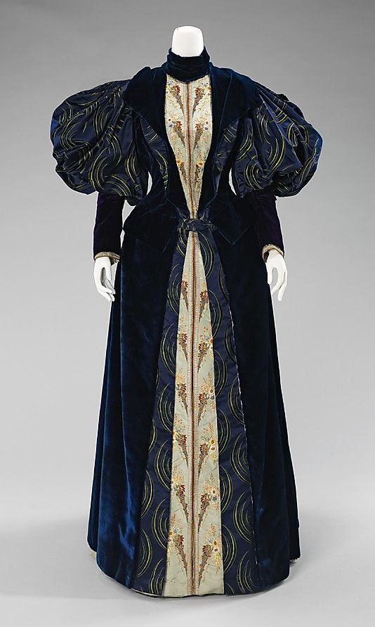 """Dress, Laboudt & Robina: 1895, French, silk.    """"The crescent textile of this glorious gown was made in China in 1888 and then included in this gown by Parisian dressmakers Laboudt & Robina at a later date. The dress itself includes what French dressmaking is famous for: striking color combinations and textures, meticulous sewing and elaborate embroidery."""" Front"""