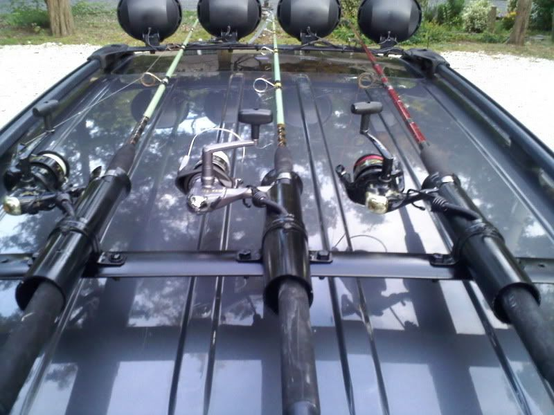 Fishing pole holder project wj jeep wj pinterest for Rooftop fishing rod carrier