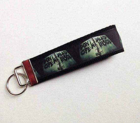 Check out this item in my Etsy shop https://www.etsy.com/listing/194252363/the-walking-dead-key-fob-keychain