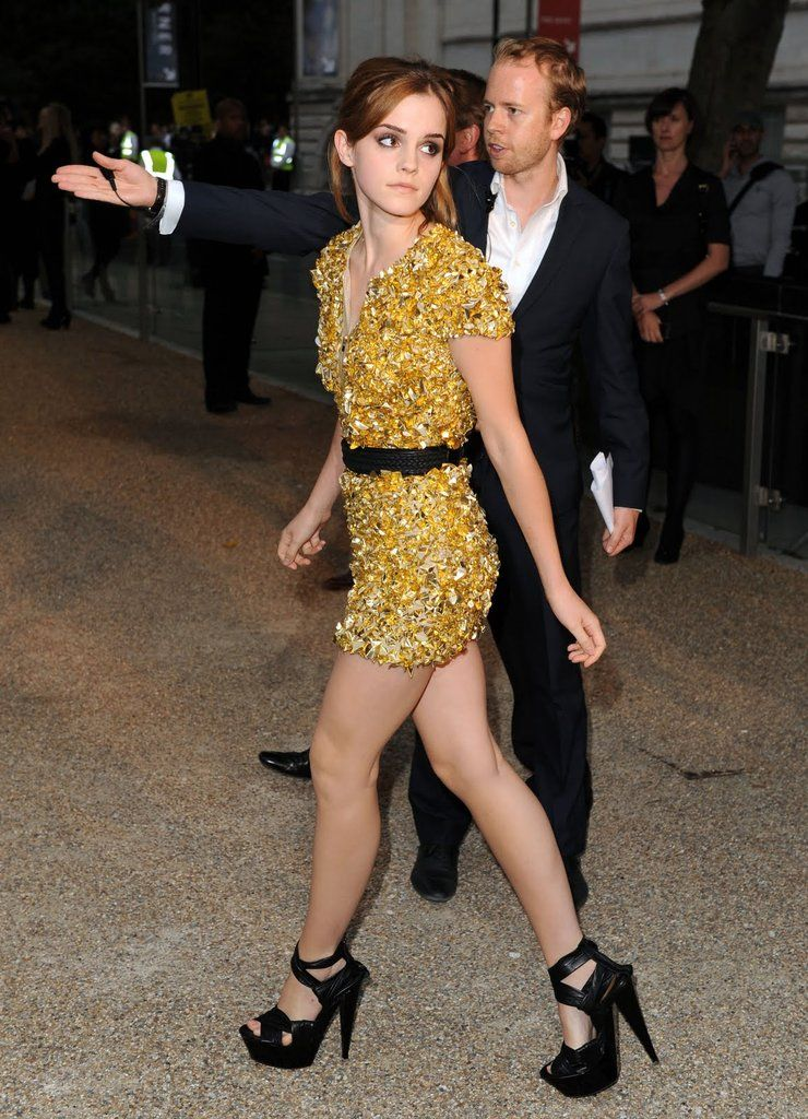Emma Watson legs in a yellow dress and black high heels ...