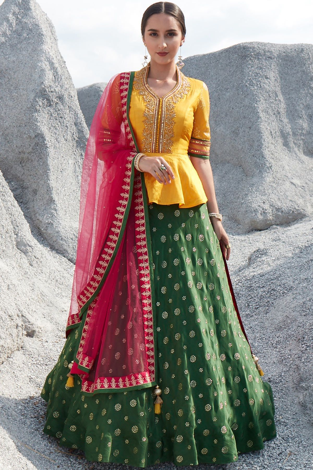 Designed with new fangled style this designer lehenga has a peplum top with a flared silhouette ...