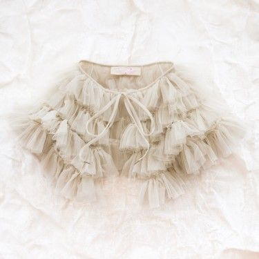 BEAUTIFUL flower girl capelet.   tutu du monde ruffled capelet  by tutu du monde  $85.00  layers of softest tulle, designed to rest on the shoulders and float down the upper arms and back. capelet has sleeve openings and tie front. imported.