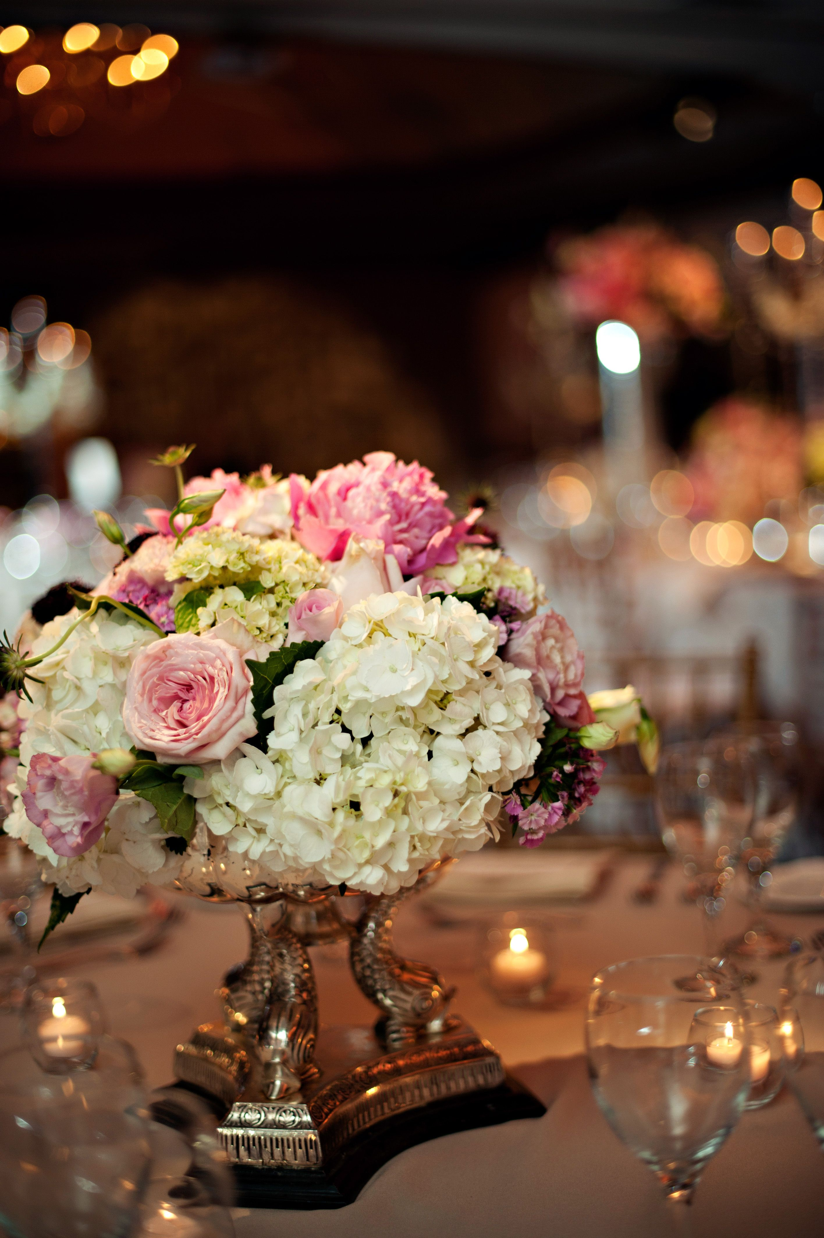 Gorgeous pastel ceremony centerpiece that includes garden roses and hydrangea! Photo credit: Bethany Fields #collegeflowers #lubbock