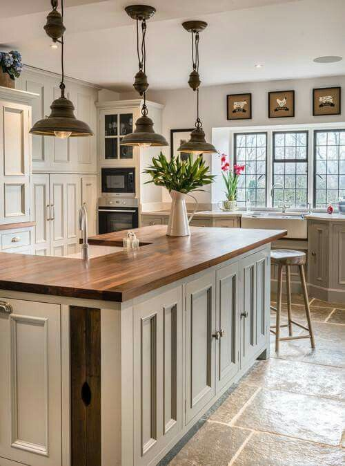 Farmhouse Touches Love The Lighting And Counter Tops In This Rustic Farmhouse Kitchen Country Kitchen Farmhouse Farmhouse Style Kitchen