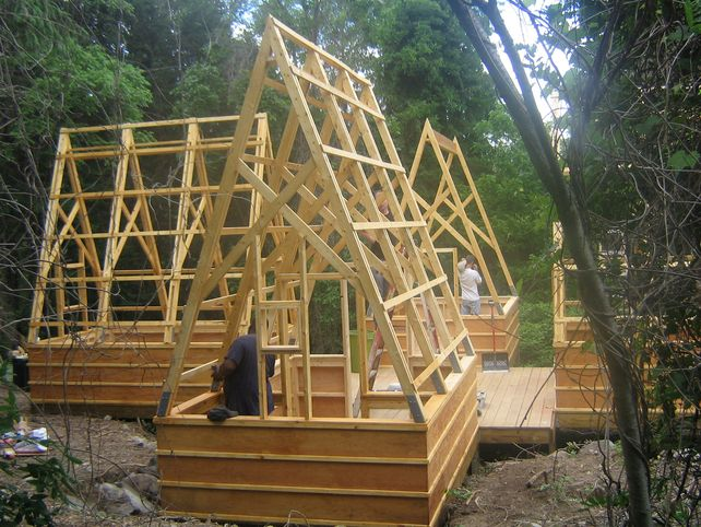 Swamp-Hut-construction-staining-the-wood