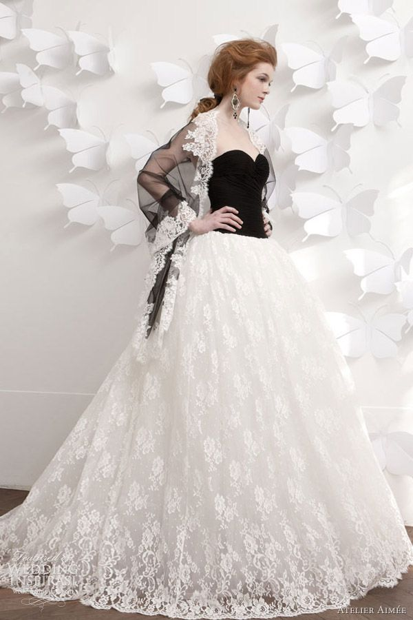 ball gown featuring black strapless bodice and white lace skirt ...