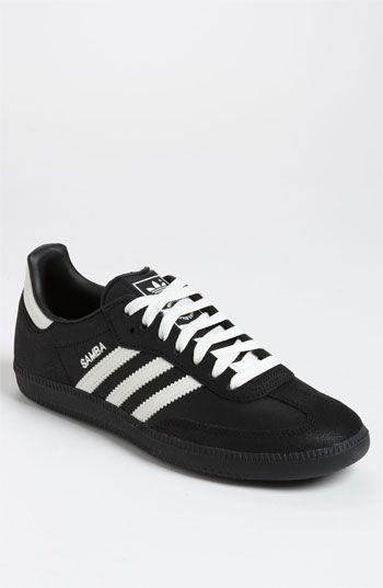 white and black adidas samba
