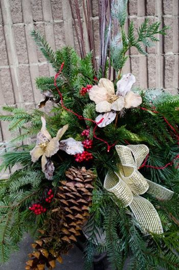 Have you ordered your Christmas porch planter yet? These gorgeous festive planters make every front door inviting and bright! #yyc #Calgary #ChristmasIsComing