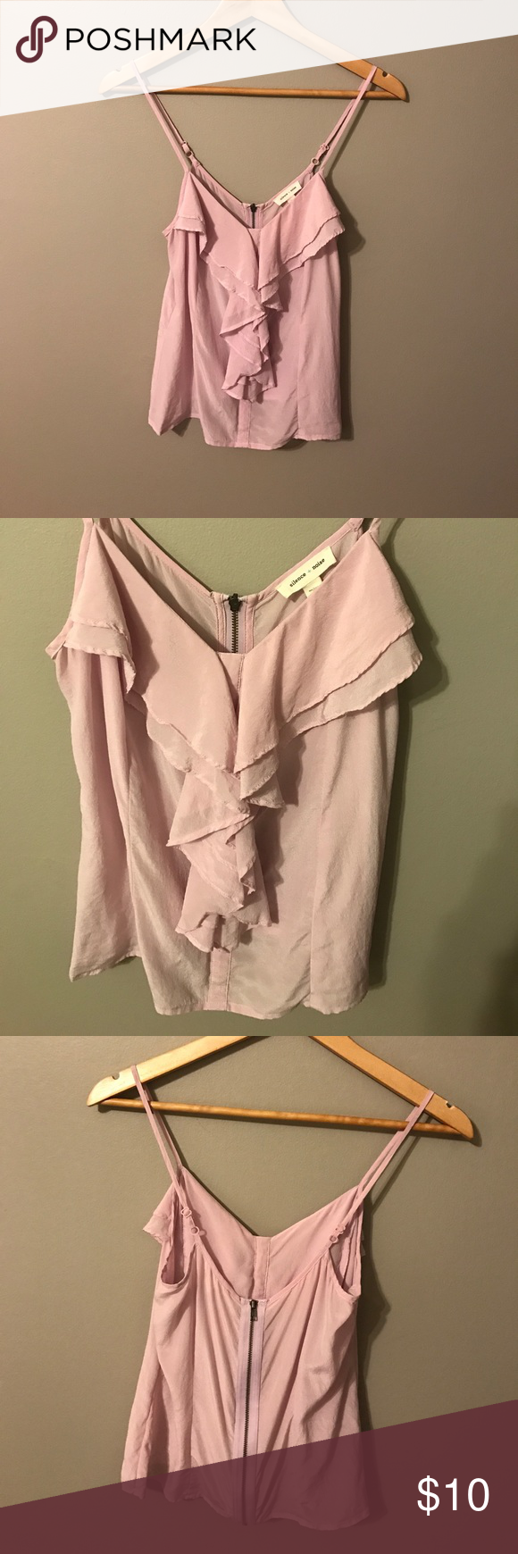 UO Silence + Noise ruffle front zip back camisole I'd say this runs a little small, more like an XS? Urban Outfitters Tops Camisoles