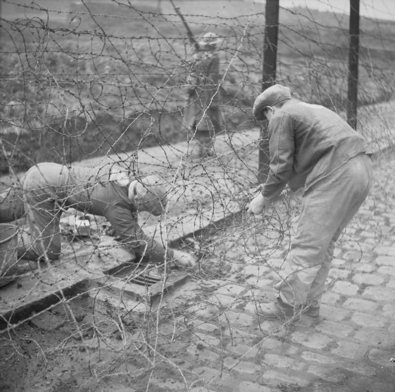 German POWs repair a barbed wire fence at Glen Mill Prisoner of War ...