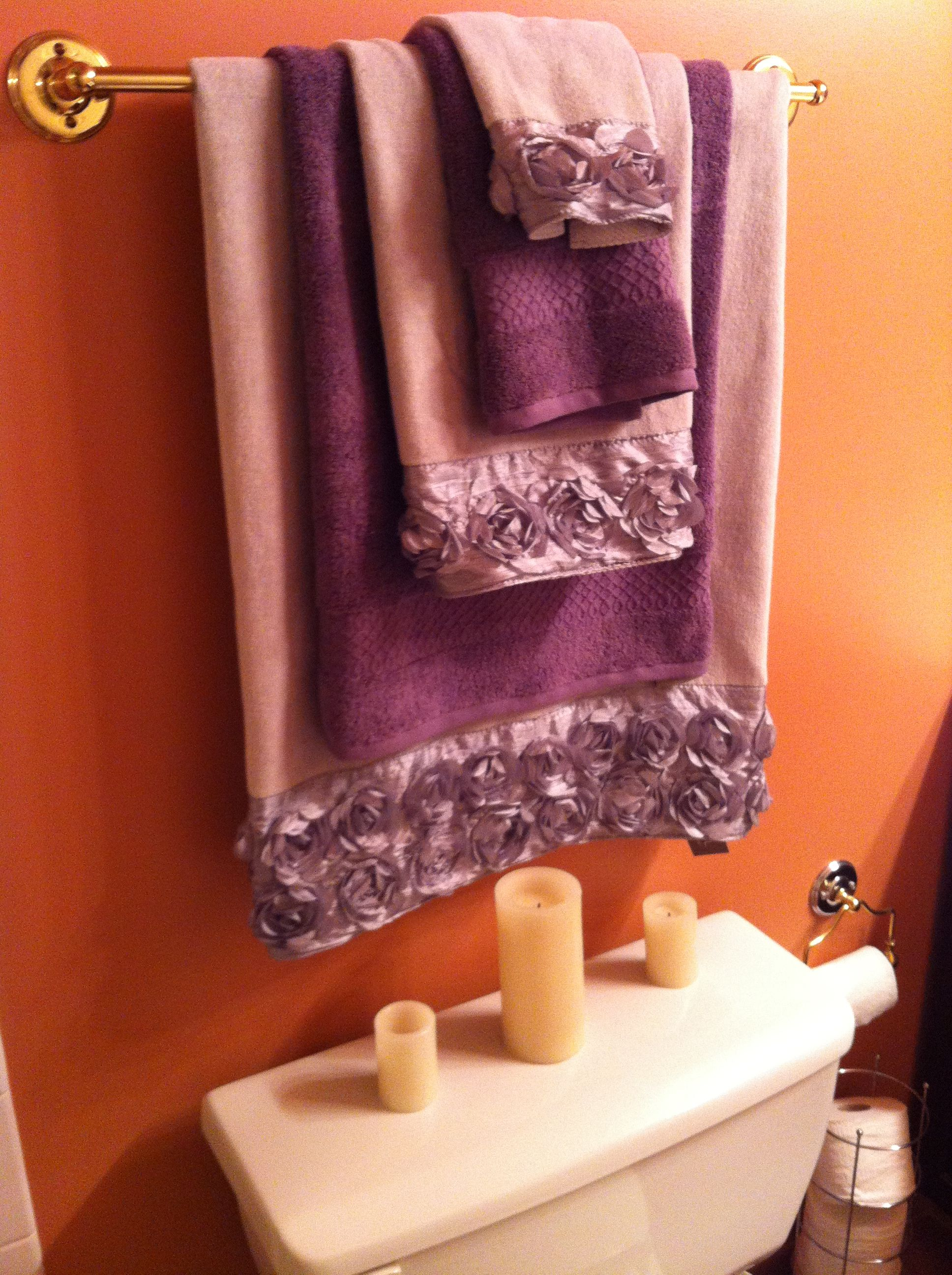 Bathroom update nice grey towels with decorative roses for Deep purple bathroom ideas