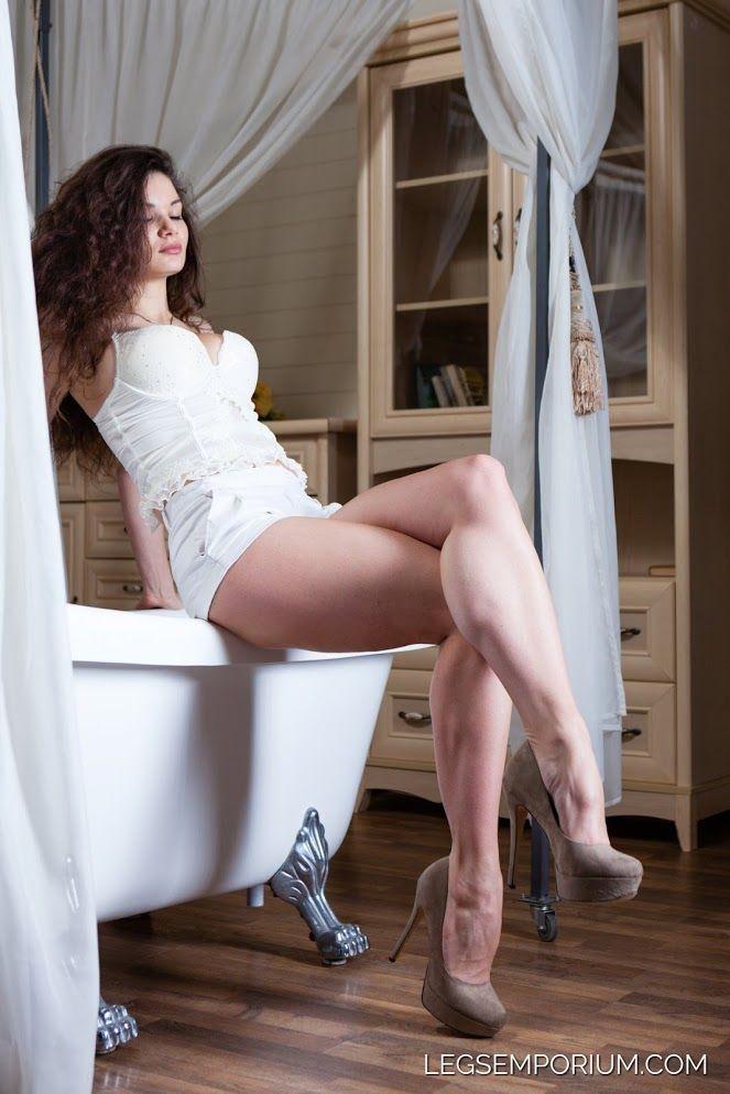 nude girl sittind legs together