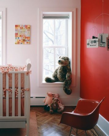 A single wall painted red, by Brooklyn-based Delson or Sherman. love the teddy bear by the window