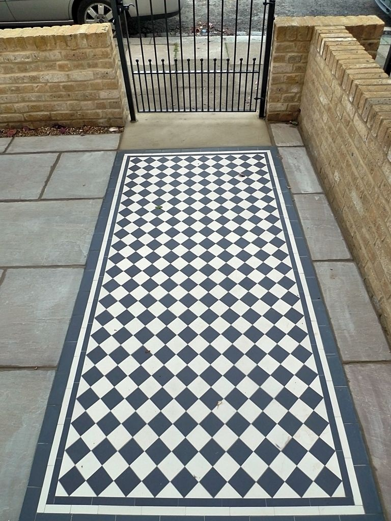 classic-70mm-black-and-white-mosaic-tile-path-with-new-brick-wall