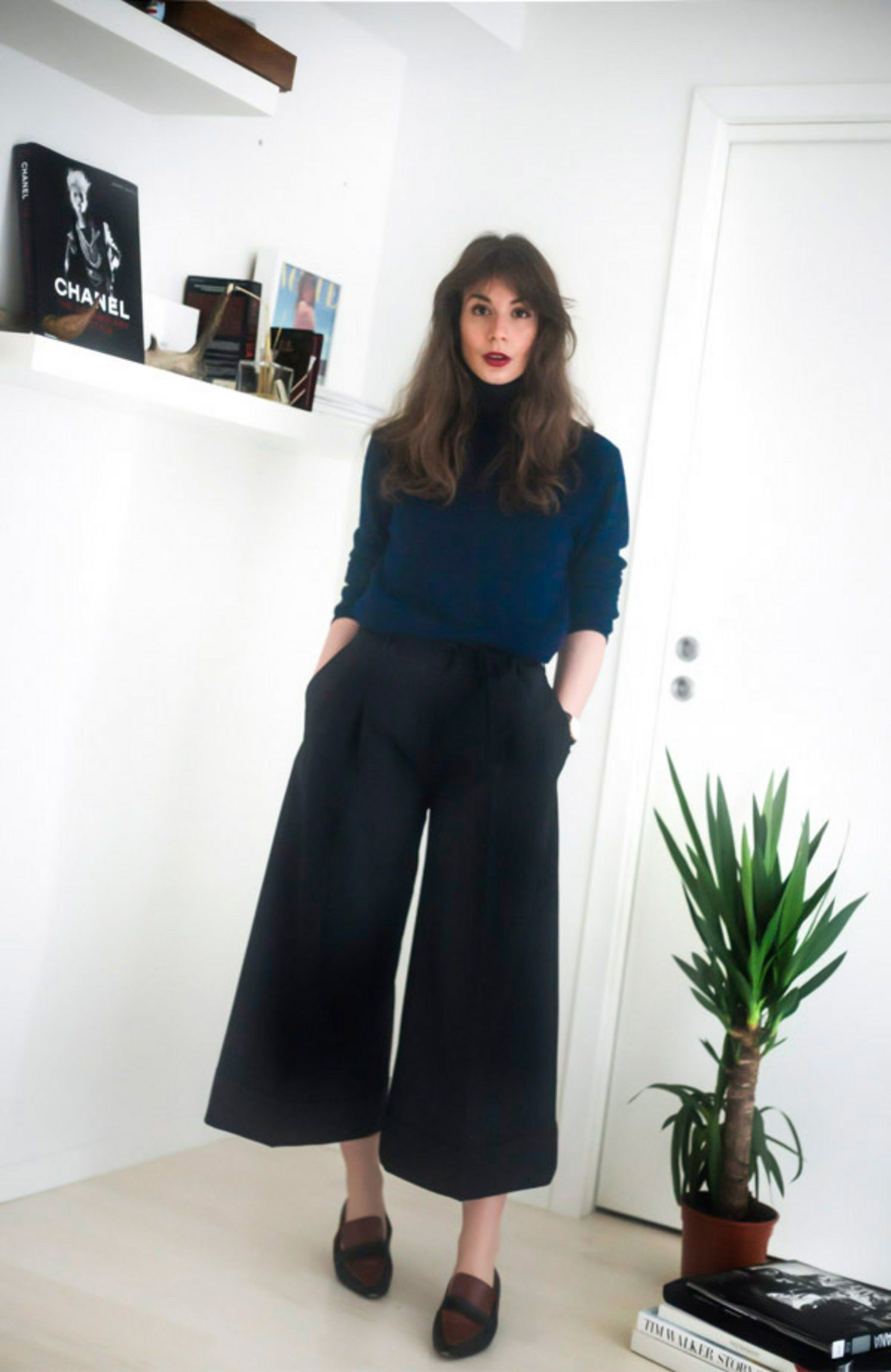 The Travel-Friendly Outfit A navy top and black culottes, like Irina  Lakicevic of A Portable Package wears here, are a great option to travel in  for ...