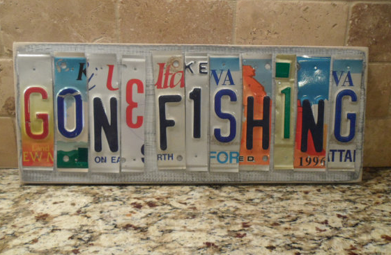 GONE FISHING sign made of old license plates..... Need for