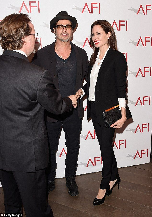 Angelina jolie suits up to take brad pitt to the afi awards meet and greet brad and angelina got in some glad handing m4hsunfo