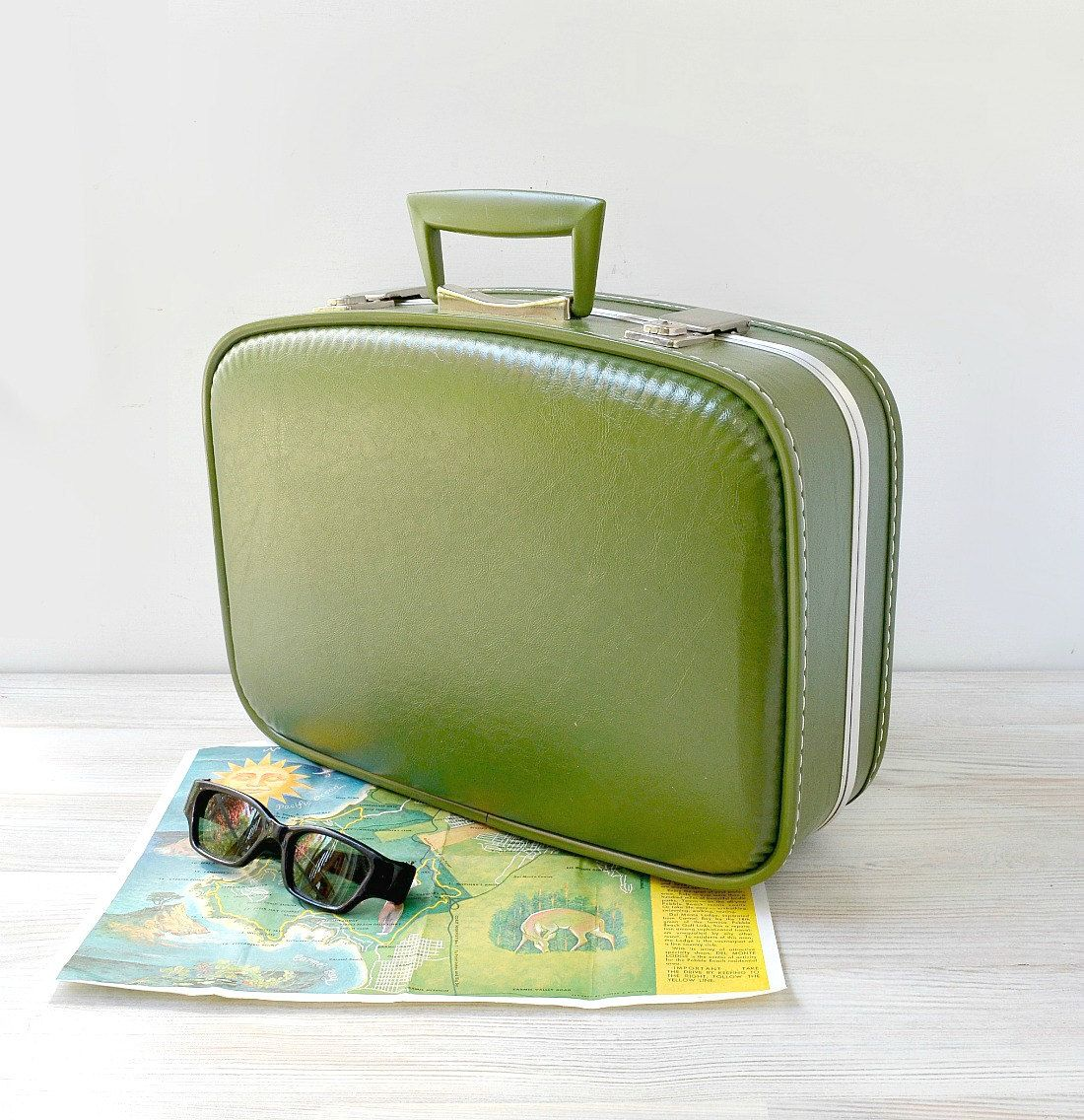 small hard sided suitcase in avocado green wedding card
