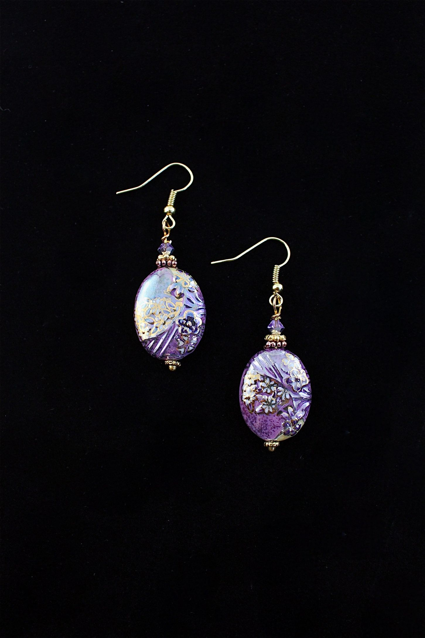 Purple Mojo Earrings...who doesn't love purple?  These purple handmade glass earrings are just the trick.  Vermeil accents and NICKEL free wires.  $58.00  www.spitfiredesignsjewelry.com