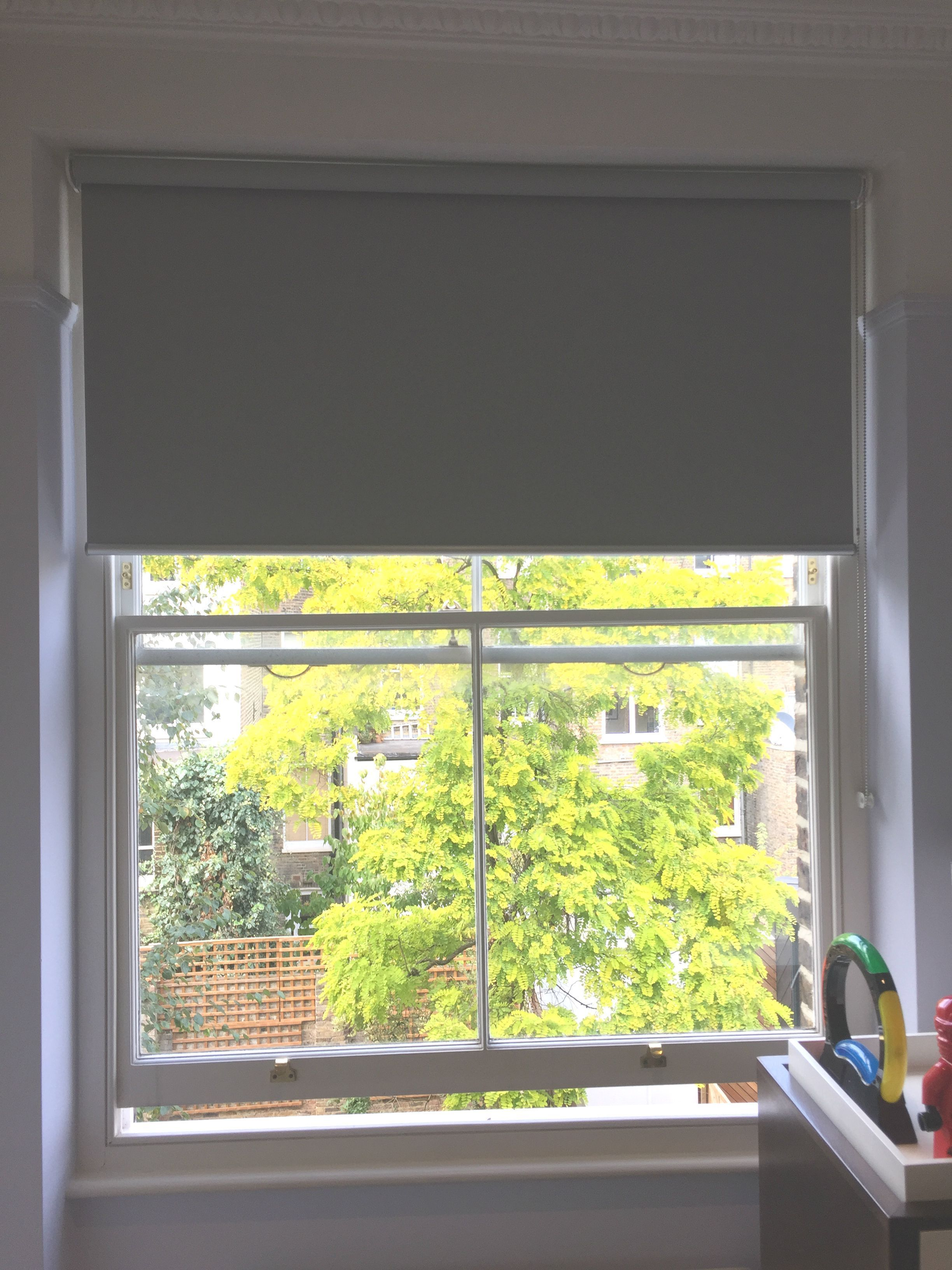 Blackout roller blind fitted to sash window in childrenus bedroom in