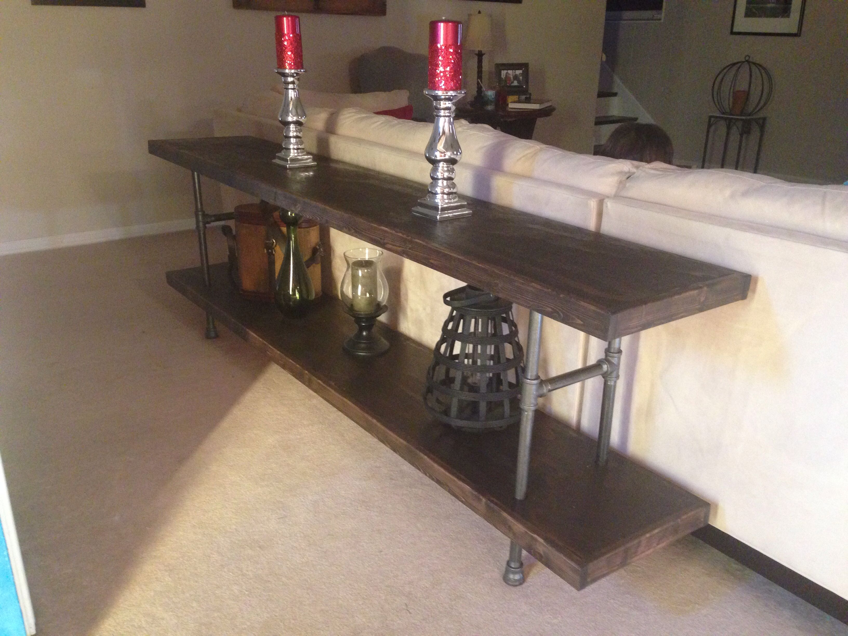 DIY Sofa table from black plumbing pipe plywood & 1x6 s