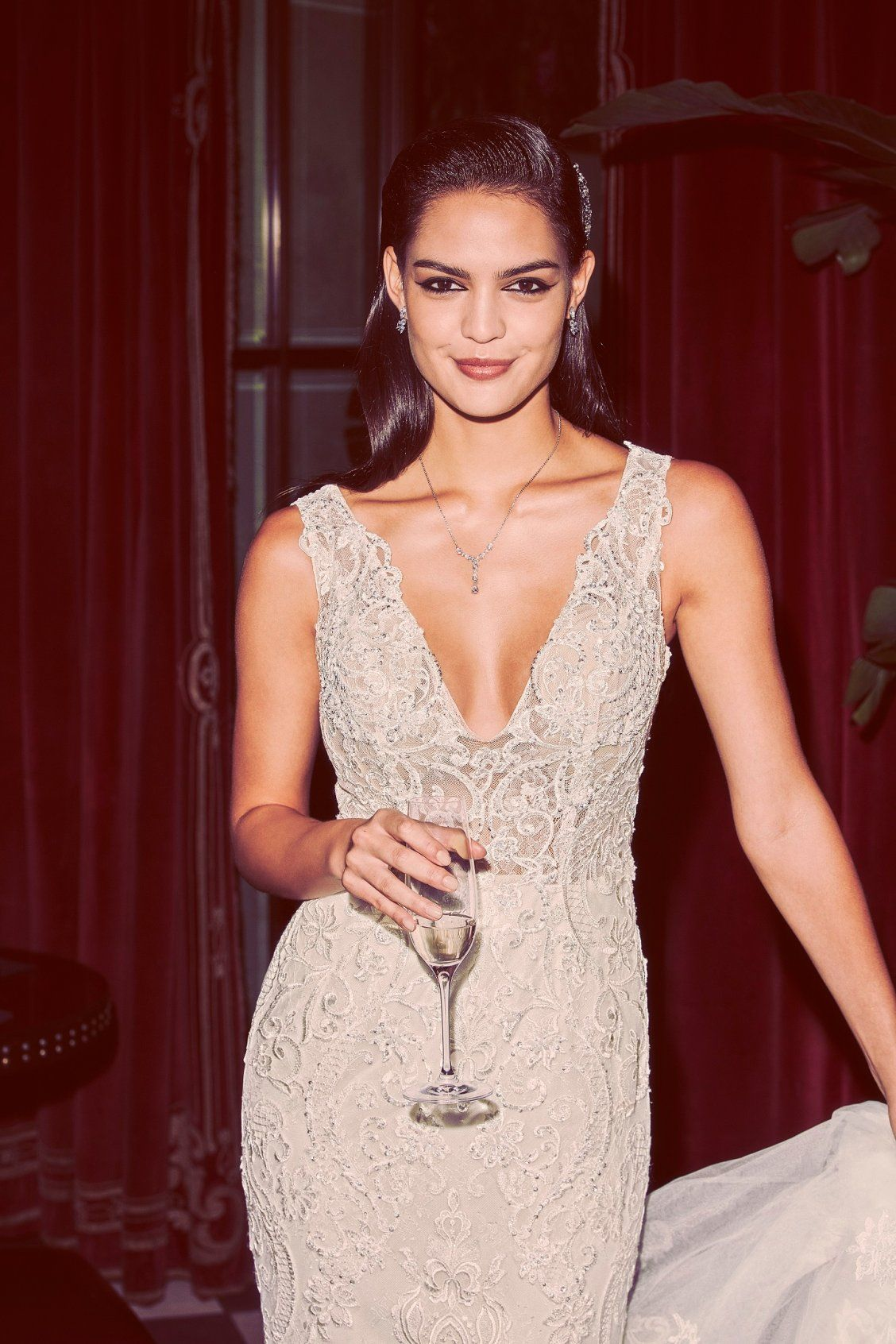 Galina signature wedding dress  Take the plunge in this vneck lace sheath wedding dress from our