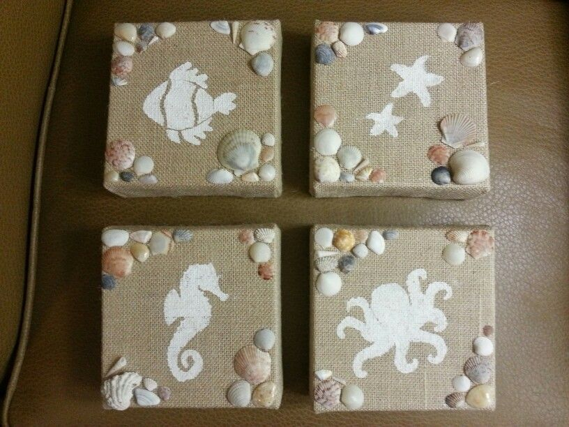 4 burlap canvases, sponge painted and decorated with shells I found at Pensacola Beach  (Sorry the photo is not that great)