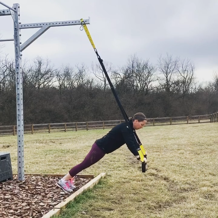 This total body exercise routine consists of pull ups, cargo net climb, TRX push up, TRX single leg...
