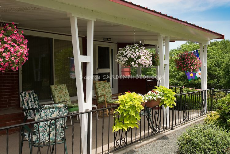 front porch house hanging plants containers and