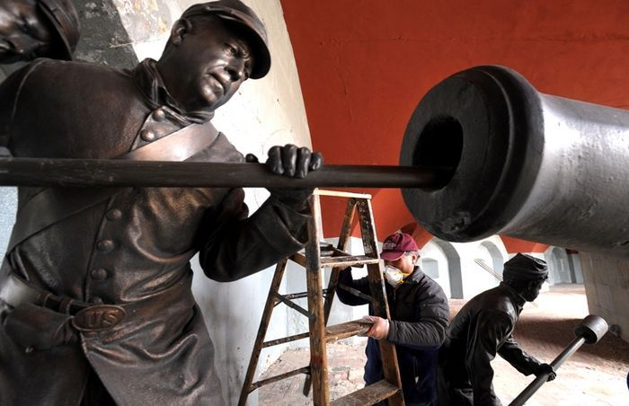 Volunteer Irving Moy is surrounded by a group of gun crew statues as he adjusts his ladder while working on painting a gun casemate at Fort Trumbull in New London as part of the Civil War Trust's annual Park Day Program Saturday March 31, 2012. This is the first year that Fort Trumbull has been designated a Park Day clean up site by the Civil War Trust. Volunteers including United States Coast Guard Academy cadets and members of the Company F of the 14th Connecticut Volunteer Infantry Civil…