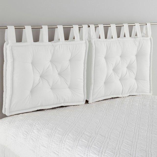 cojn de cabecero de cama con un bonito acabado de cordones anchos que le aportan mucho