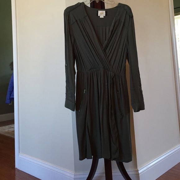 Maeve (Anthropologie) green faux wrap dress Maeve brand olive green faux wrap utility dress. Brass colored accents. Size medium. Hits around the knee. Used but in good condition. 55% Viscose, 45% Rayon but machine washable. The fabric as a crinkle appearance. Purchased from Anthropologie earlier this year. Maeve Dresses Long Sleeve