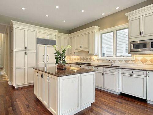 antique white kitchen cabinets wall color slate floor green backsplash