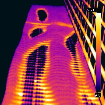 This picture shows the heat loss from a tower block, environmentally friendly ! think not.    Image:© Russ Miller- Johnson