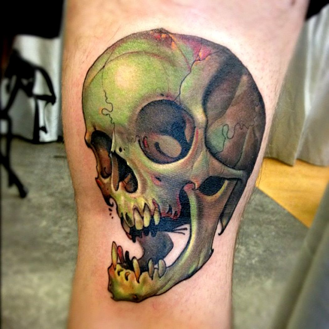 Skull tattoo by curtis burgess at tribal rites tattoo in for Tribal rites tattoo piercing fort collins co