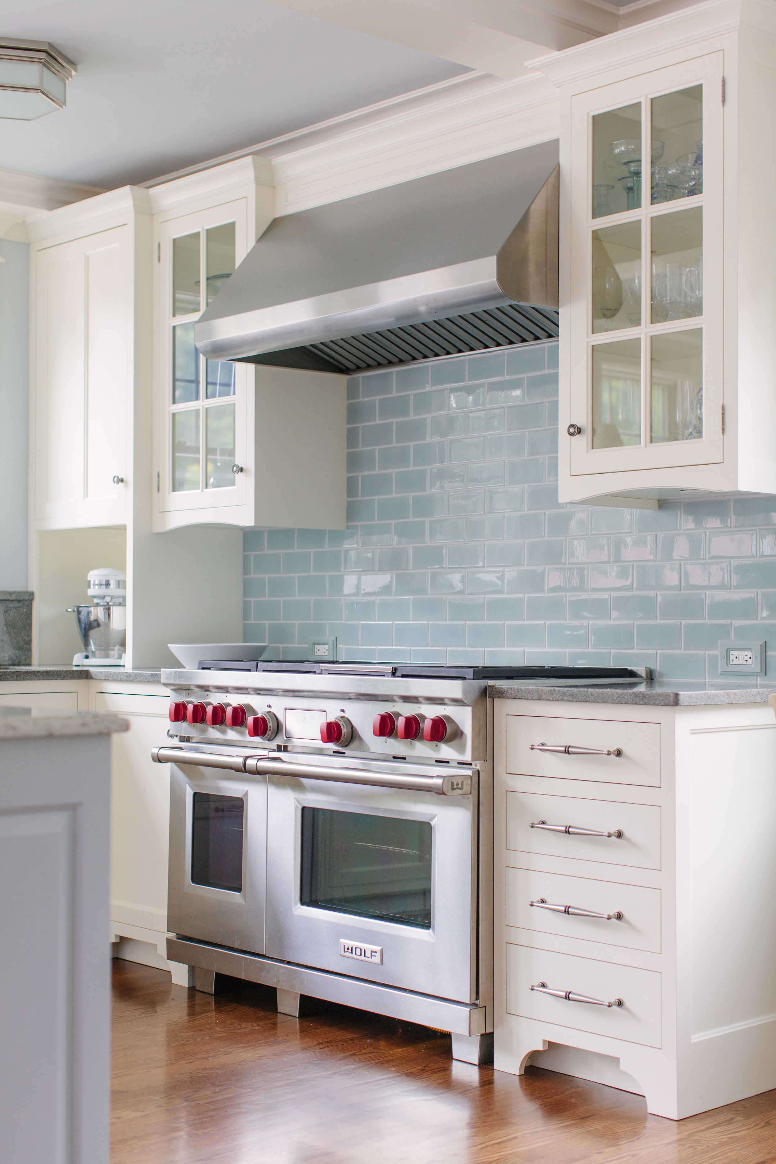 love this classic white kitchen with pale blue subway tile
