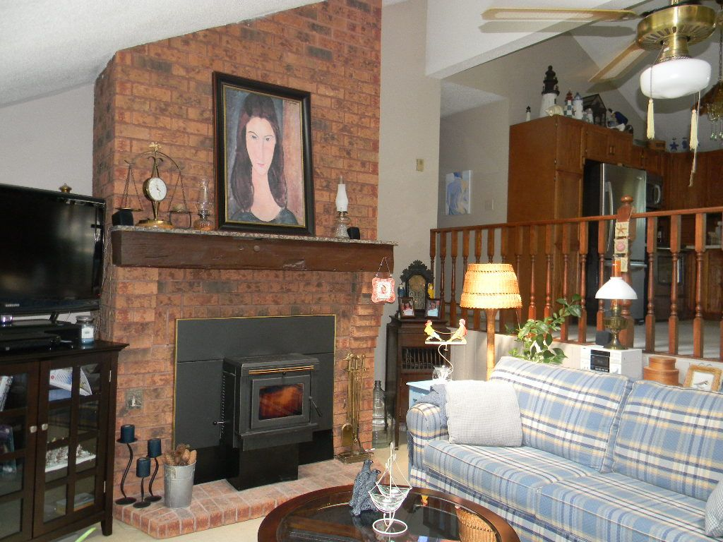 Cozy up to this pellet stove fireplace on those cold winter nights over looking Barcovan Beach