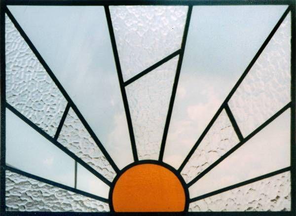 An original panel brought for repair with classic Art Deco sun motif ...