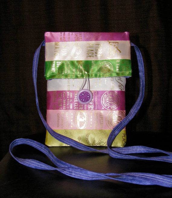 Shoulder purse from vintage AKC dog show ribbons. Horse, dog, 4H, track, swimming, pageants. Pink, purple, green. Ribbon display. Rosettes and awards. Ribbon quilting. Agility obedience training conformation. Repurposed vintage. Upcycle. Handmade.