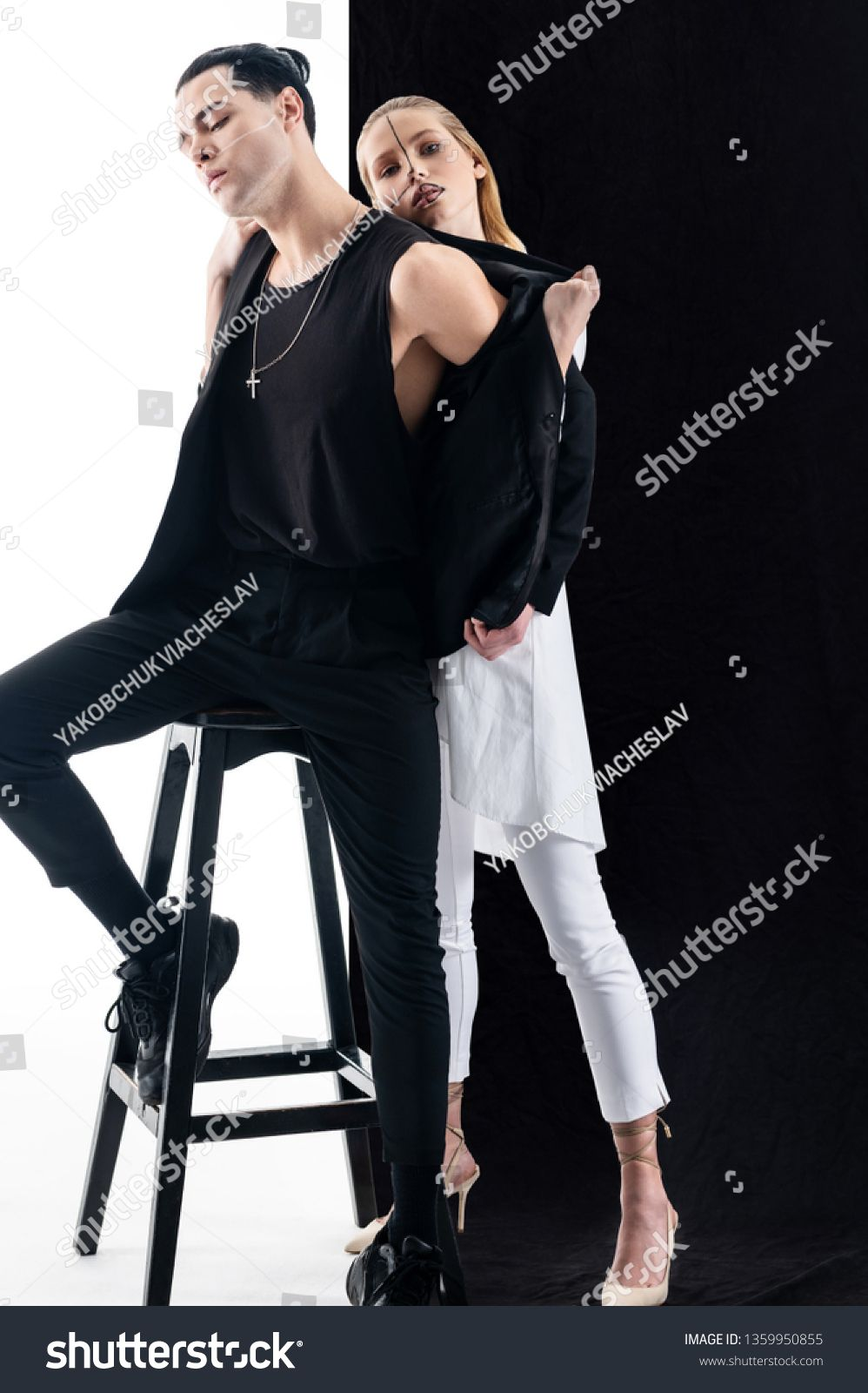Yin or yang. Young models with amazing appearance working in yin and yang photo session ,
