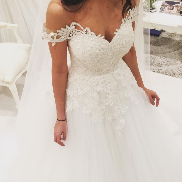 Heavy embellishment off the shoulder ball gown wedding dress #wedding #weddingdress #weddinggown