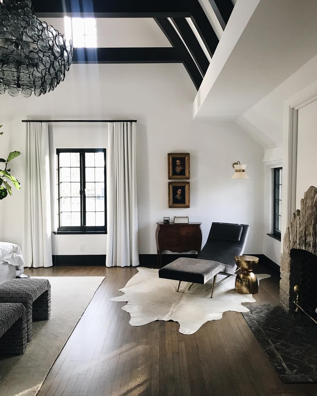 Modern Minimalist Master Bedroom With Cowhide Rug And Black Leather Chaise Lounge Home Mediterranean Home Decor Living Room Designs