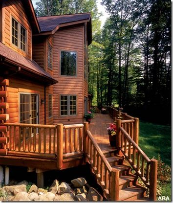Large log house with big wrap around deck this maybe for Log home decks