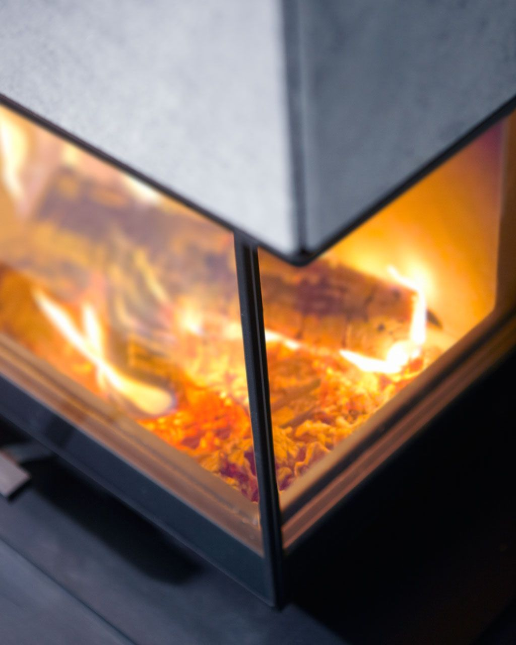 Angled glass door available in both left and right. #soapstone #fireplace #contura http://www.contura.eu