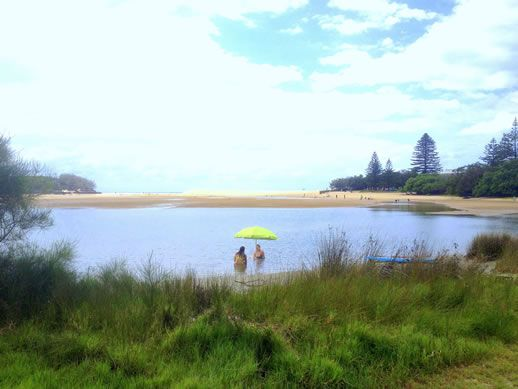 currimundi lake by electric bike - Caloundra Coasting: Exploring Six Beaches on Electric Bikes ~ www.parkmyvan.com.au #ParkMyVan #Australia #Travel #RoadTrip #Backpacking #VanHire #CaravanHire