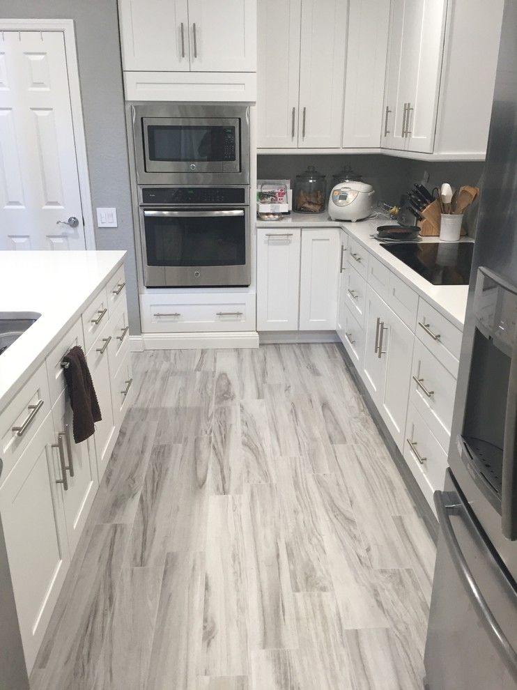 Gray And White Kitchen Luxurious Transitional Kitchen 12 X 24 Kitchen Ideas Is Accented With Transitional Kitchen Islands Kitchen Wall Color Kitchen Transi Grey Wood Floors Kitchen Grey Kitchen Floor Grey Laminate Flooring