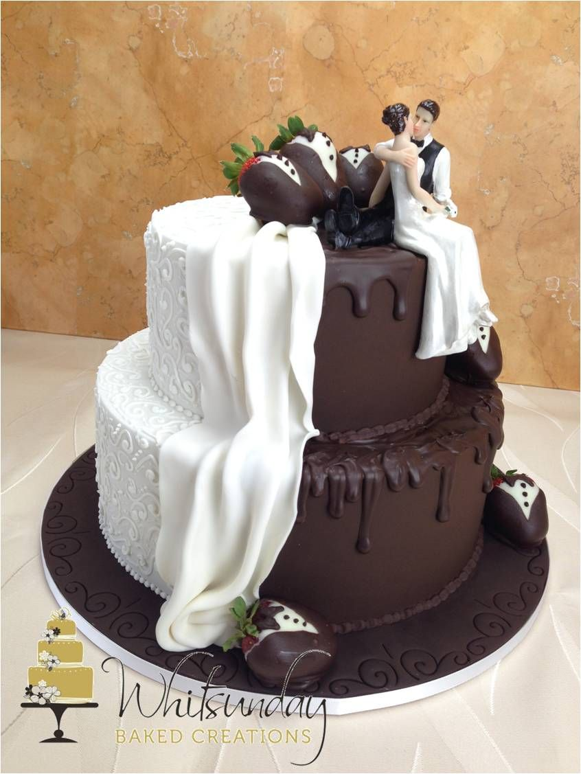 A Two Tier Wedding Cake Half In Chocolate And Half In