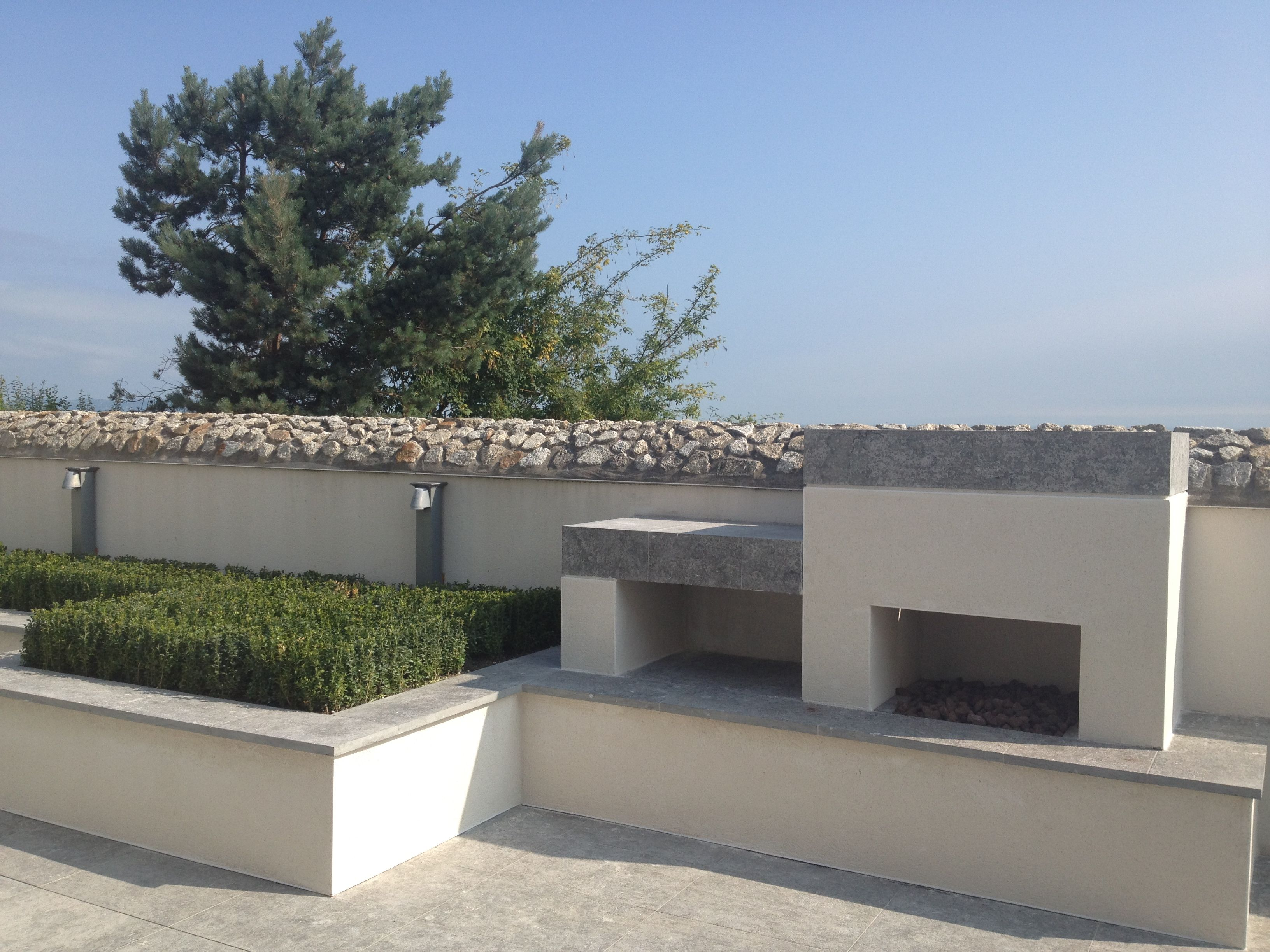 buxus pad rendered raised bed and outdoor fireplace with