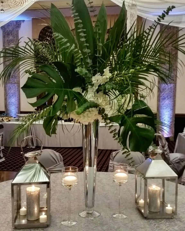 Hawaiian Wedding Reception Ideas: Tropical Centerpieces With Lanterns Echoing A Palm Beach